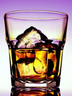 Glass of Whiskey with Ice Cubes Photographic Print by Peter Howard