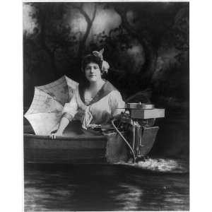 Young woman posed with Evinrude outboard motor,c1913