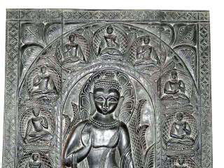 hand carved wall panel. Different mudra of buddha carving door panel